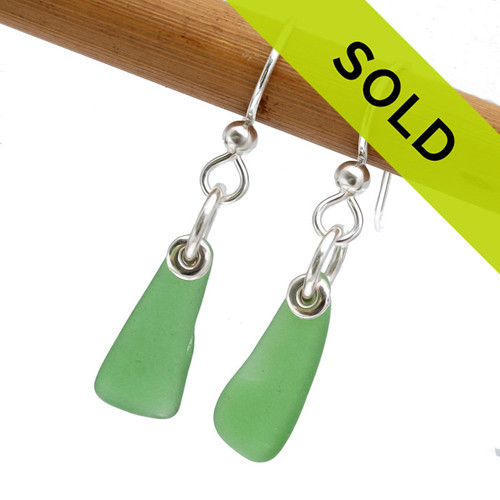 Sorry these petite green sea glass earrings in sterling silver have sold!