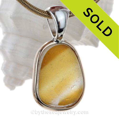 A lovely Warm Golden Yellow color mixed in white reminiscent of warm Summers. This Genuine Seaham Multie set in our Tiffany Deluxe Wire Bezel© in Solid Sterling Silver.