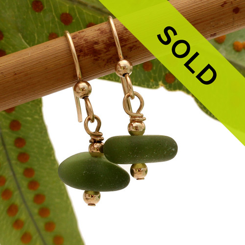 Very round and frosty pieces of genuine beach found jungle green sea glass in a simple drop gold earrings