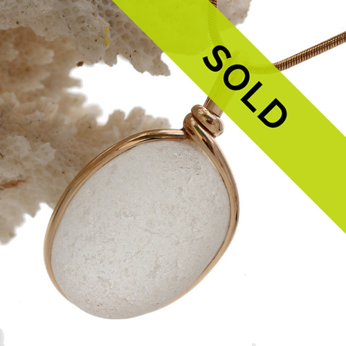 A perfect oval of frosty white English sea glass set in our Original Wire Bezel© setting in gold. This is amazing quality sea glass and a perfect color for any time of year! Shown here on a 18 inch goldfilled snake chain (NOT INCLUDED - but recommended and available as an upgrade).