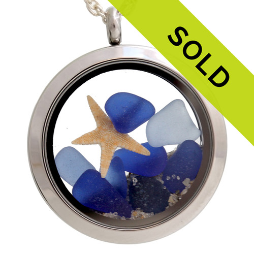 Light and dark cobalt blue sea glass locket with starfish. Just like the beach the contents change. Sorry this locket is sold!
