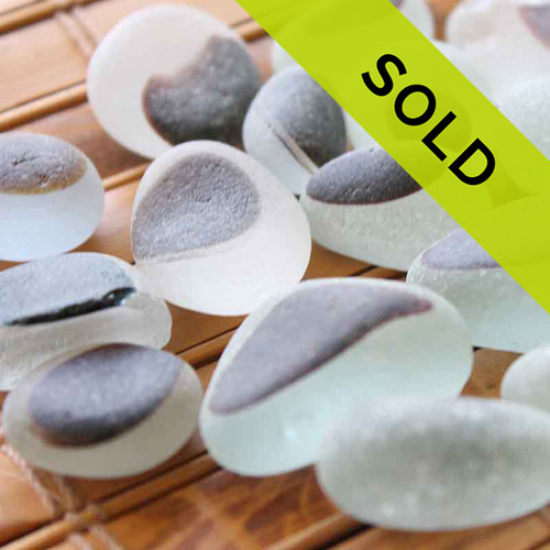 17 pieces of mixed whitish and chocolate English Sea Glass pieces from Seaham England Sorry this lot is no longer for sale.