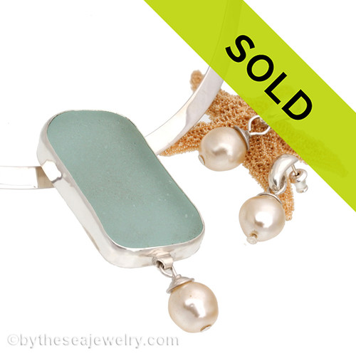 Stunning and perfect aqua sea glass is set in a fine sterling bezel and backed in sterling. This necklace comes WITH a solid sterling oval neck collar and matching earrings. Sorry this one of a kind sea glass jewelry piece has been sold!