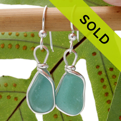Vivid tropical aqua sea glass from Hawaii is set in our Original Wire Bezel© setting for a stunning pair of earrings. Sorry this sea glass jewelry item has been sold!