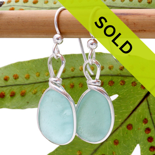 Lighter aqua sea glass earrings in our Original Wire Bezel© earring setting. This setting leaves the sea glass UNALTERED from the way it was found on the beach in Hawaii. This pair has sold!