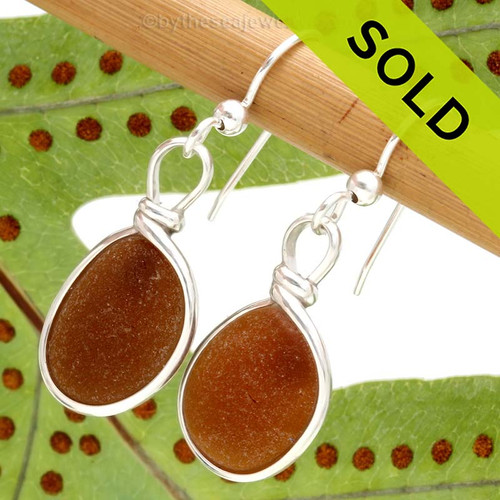 Beautiful amber brown sea glass pieces left just the way they were found on the beach in Puerto Rico are set in our Original Wire Bezel© setting. This is the EXACT pair you will receive! Sorry these Sea Glass Earrings have been SOLD!