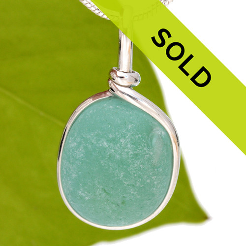 A beautiful thick piece of aqua green sea glass set for a necklace in our Original Sea Glass Bezel© setting Sorry this pendant has sold!
