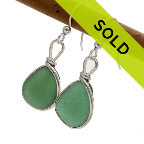 Sorry this pair of green sea glass earrings in a sterling bezel have been SOLD!
