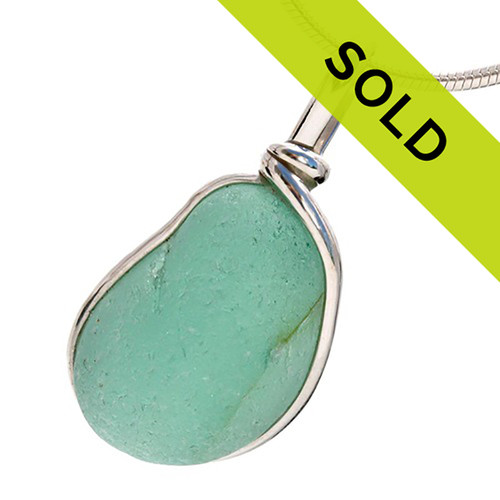 Great piece of natural sea glass in my Original Sterling Silver Wire Bezel© a simple design that lets all the beauty of this glass shine. Top quality sea glass.  Sorry this piece has been sold!