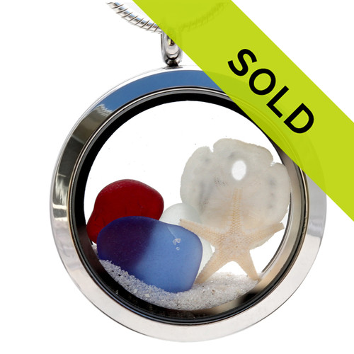 Real red, white and blue sea glass combined with a real starfish and sandollar and finished with powdery white beach sand. Sorry this locket has been SOLD!