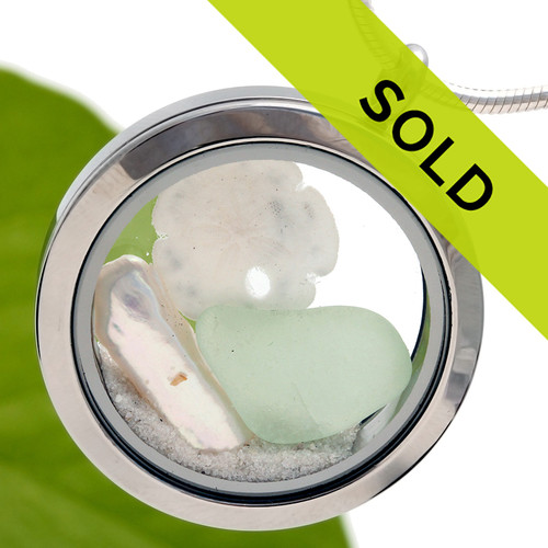Cool seafoam green sea glass combined with fresh water pearl and a real sandollor in this Stainless steel locket. Real Florida beach sand completes the look. Sorry this locket has SOLD!