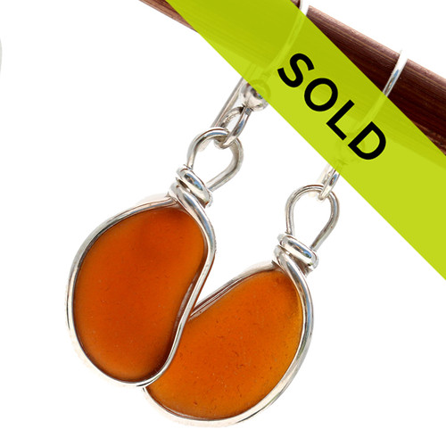 Vivid bright amber brown sea glass pieces left just the way they were found on the beach in Puerto Rico are set in our Original Wire Bezel© setting. This is the EXACT pair you will receive! Sorry this pair has sold