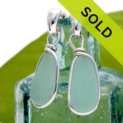 These beautiful sea glass earrings have been sold.  Please view our available earrings from our sea glass jewelry tab.