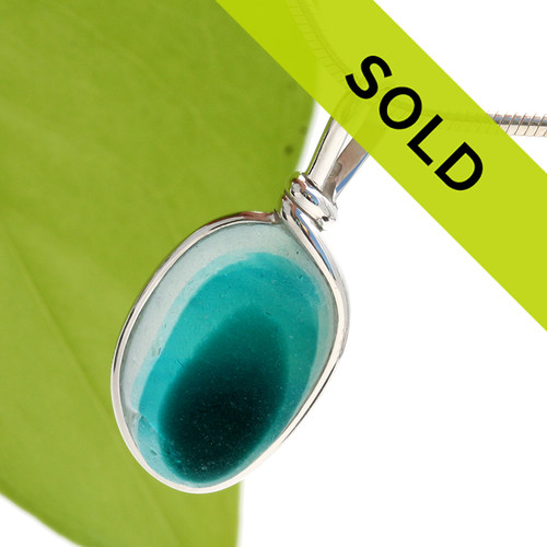 This mixed aqua sea glass pendant in sterling has been sold!