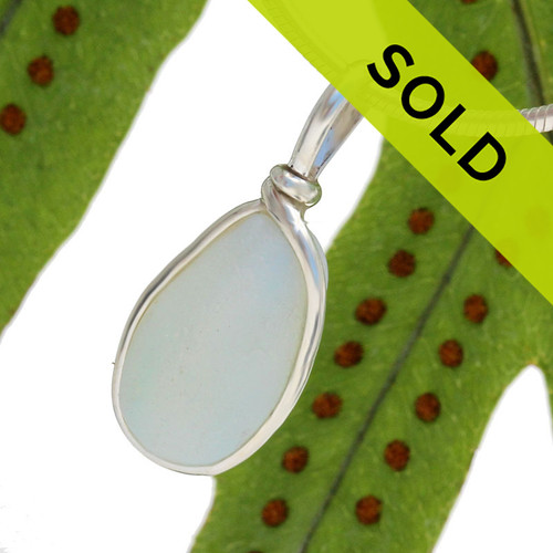 Sorry this beautiful opalized sea glass pendant has been sold!
