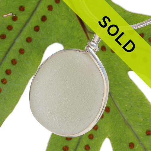 Pure white sea glass pendant in our sterling silver Original Wire Bezel© setting. This setting securely encases the sea glass without altering or damaging it!