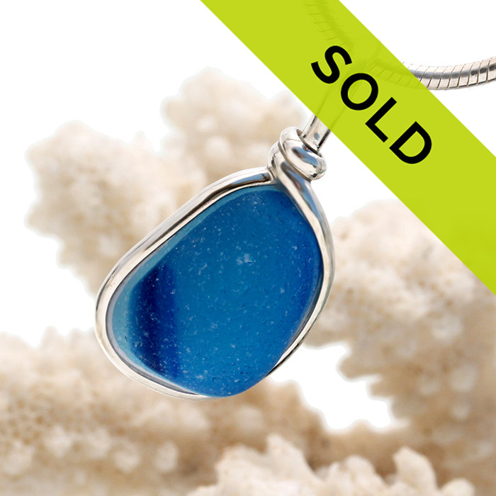 Beautiful mixed blue sea glass from England set in our Original Wire Bezel© setting in sterling silver. Shown here with our sterling snake chain (NOT INCLUDED - but recommended with this style and available as an upgrade). So sorry this exact piece has been sold!