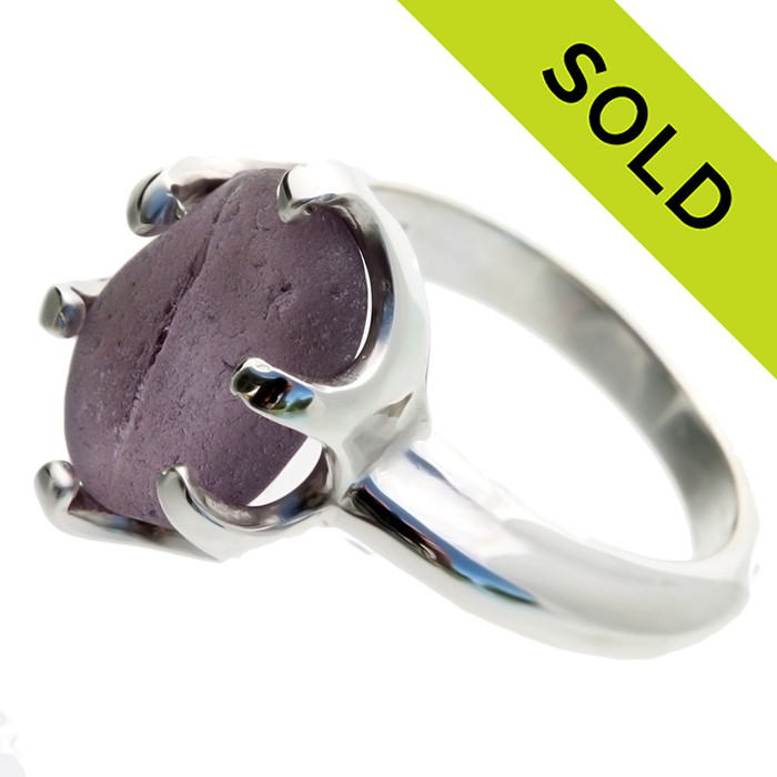 This amazing piece of deep purple English sea glass was left just the way it was found on the beach. It is set in a professional grade solid sterling cast ring. SOLD - Sorry this Ultra Rare Sea Glass Ring is NO LONGER AVAILABLE!