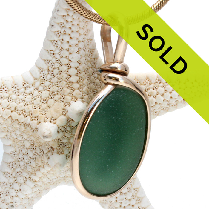 Perfect piece of seaweed green natural sea glass set in our 14K Rolled Gold Original Wire Bezel© setting. This setting leaves the sea glass piece totally UNALTERED from the way it was found on the beach.  Sorry this piece has sold!