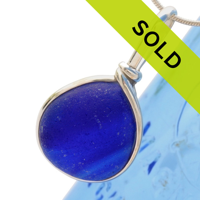In brighter light you can see the lines running inside this unique piece of sea glass from England. This is the result of slag or scrap glass being discarded into the local waters. Colors were accidentally mixed together making this sea glass piece the only one of its kind in the world!