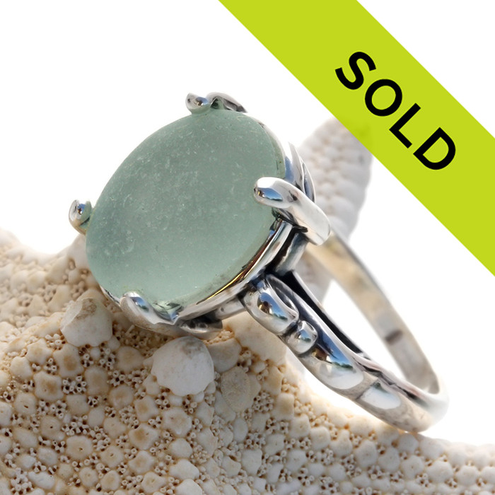 This is a natural piece of sea glass set in a 4 prong setting. Re-sizing is available!