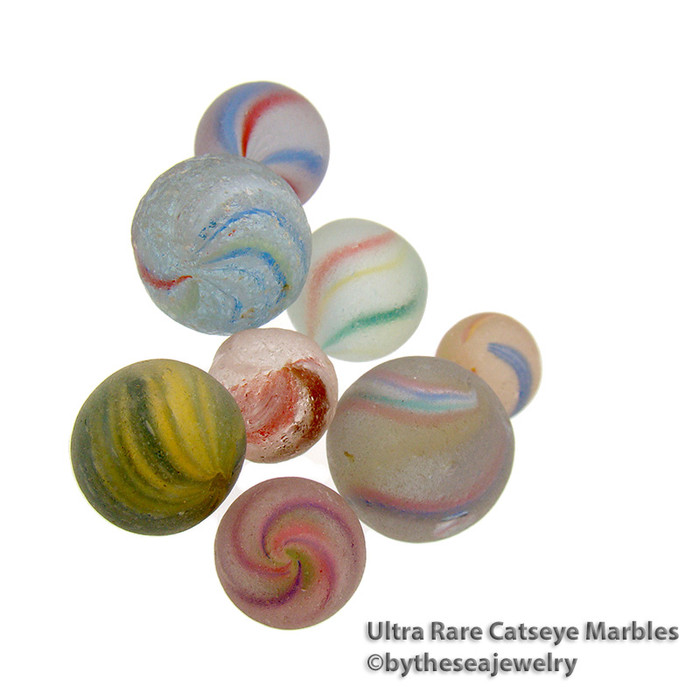 Sea Glass beach found marbles are among the rarest of beach finds in most regions of the world. Catseye marbles are the most found. Onionskin marbles are some of the rarest. These handmade treasures were prized by children as toys.