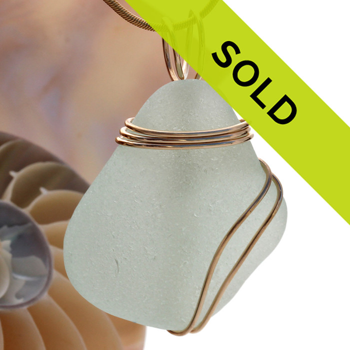 A perfect seafoam green sea glass piece set in our triple wire wrap in gold. This setting leaves the sea glass totally unaltered from the way it was found on the beach.