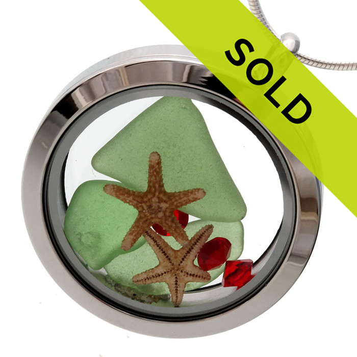 Green sea glass is combined with two real starfish and vivid red gemstones for a holiday inspired sea glass locket. Sorry this piece has SOLD!