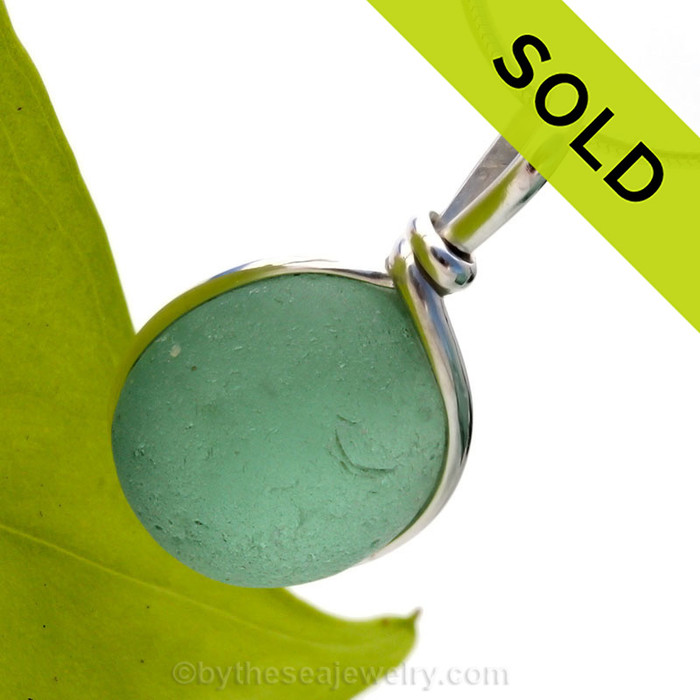 A perfect piece of aqua green sea glass in our Original Wire bezel© necklace pendant setting. Sorry this sea glass jewelry selection has been sold!