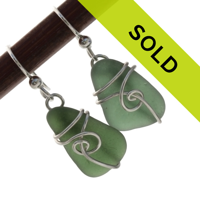 Olive green sea glass earrings is a simple sterling sea swirl setting. Sorry this pair has SOLD!