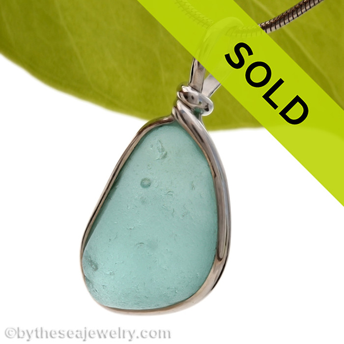 A beautiful thick piece of bubbly aqua green sea glass set for a necklace in our Original Sea Glass Bezel© setting. Sorry this sea glass jewelry selection has been SOLD!