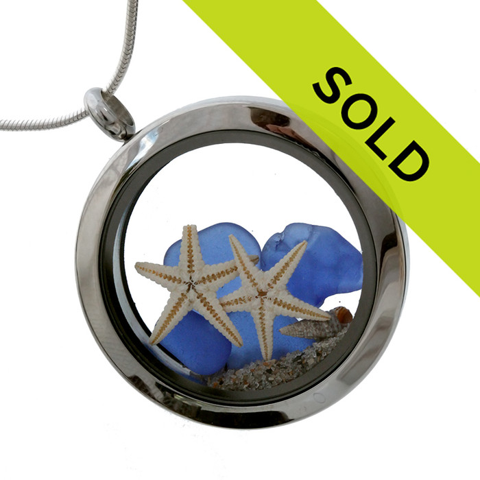 Beautiful blue sea glass combined with a starfish and a shell in a stainless steel locket Sorry this piece has sold!