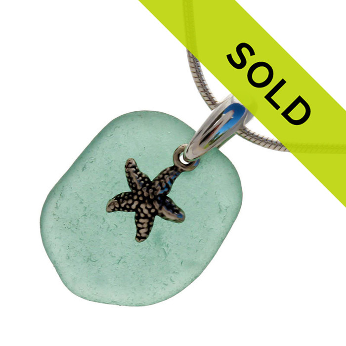 """Vivid aqua green sea glass set on a solid sterling cast bail with a sterling silver starfish charm. The sea glass necklace comes on our 18"""" solid sterling smooth snake chain (SHOWN and included). Sorry this necklace has sold!"""