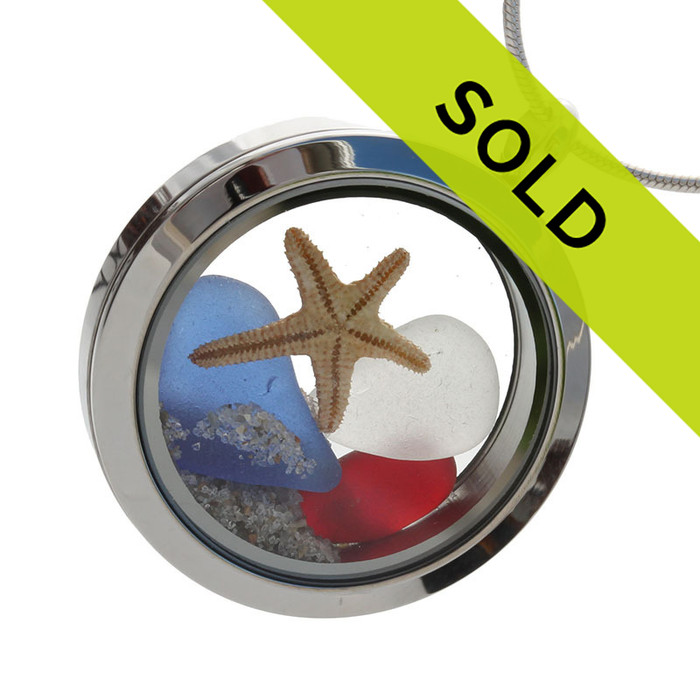 Red , white and blue sea glass are combined with a real baby starfish in this stainless steel locket necklace. SORRY THIS LOCKET HAS SOLD!