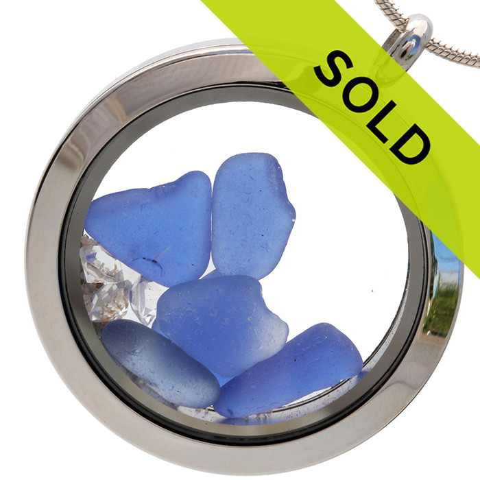 Small pieces of natural beach found blue sea glass combined with 3 clear crystals in a stainless steel locket!  SORRY THIS PIECE HAS SOLD!