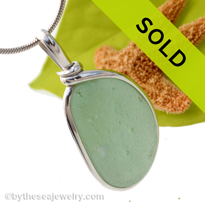 Our Original Sea Glass Bezel© 2000 setting really makes this glow! Sorry this sea glass necklace pendant has been sold!
