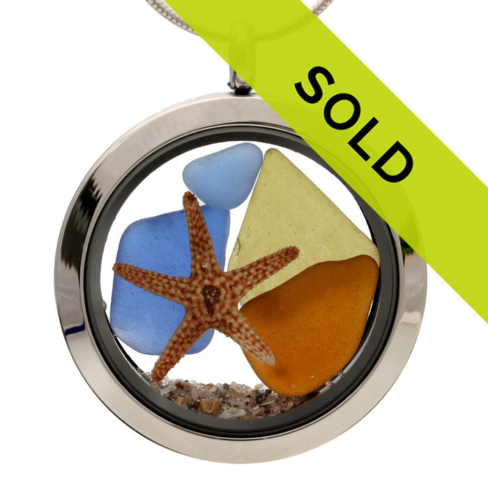 Sea glass in jeweltone colors of green, amber and blues combined with a real starfish and beach sand in this one of a kind stainless steel locket necklace. The olive green piece is very cool with embossing on it.  SORRY THIS PIECE HAS SOLD!
