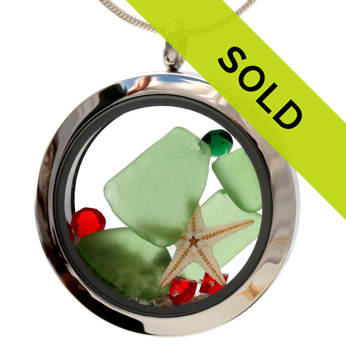 Green sea glass and vivid red and green gemstones make this a great locket necklace for the holidays