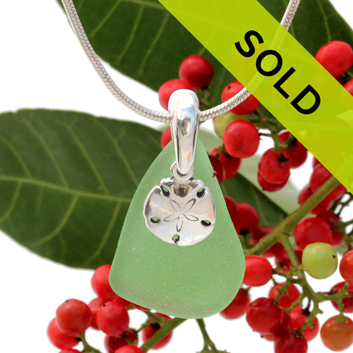 Beach found green sea glass is combined with a solid sterling sandollar charm and presented on an 18 Inch solid sterling snake chain.