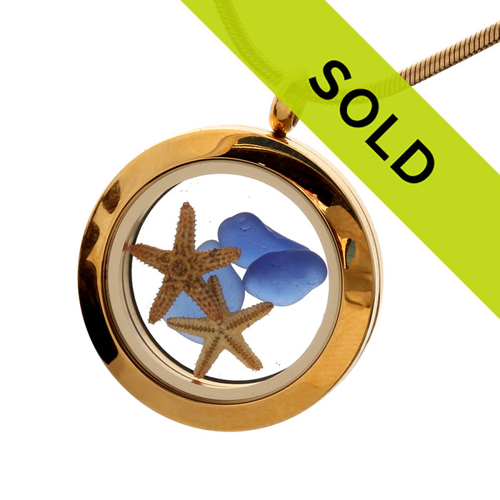 Cobalt blue sea glass and two real starfish in this goldtone stainless steel locket. Simple and Elegant!
