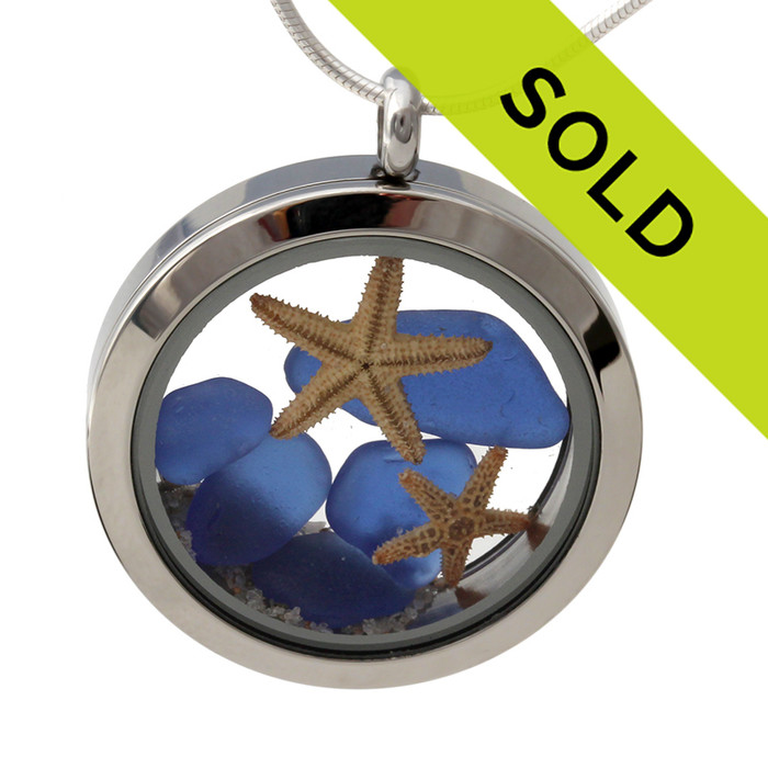 Small pieces of natural beach found blue sea glass combined with a two real starfish and beach sand for your own personal beach on the go!