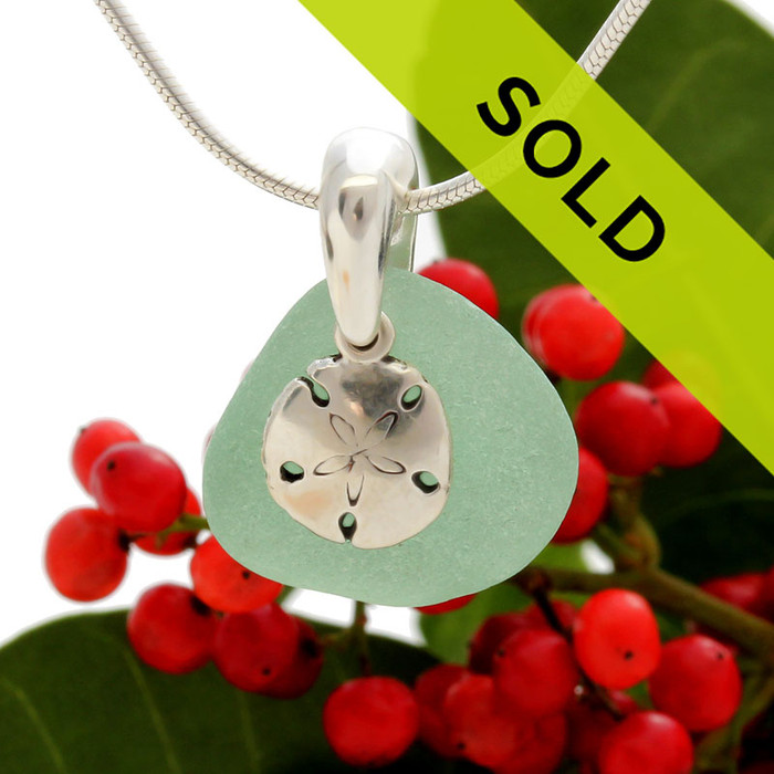 Seafoam green sea glass is combined with a solid sterling sandollar and presented on an 18 Inch solid sterling snake necklace chain.