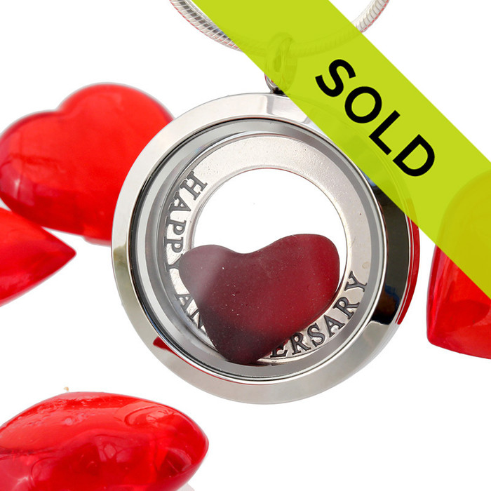 Real beach found ruby red sea glass heart combined a real starfish a sterling silver Happy Anniversary charm are combined in this Stainless steel locket necklace.
