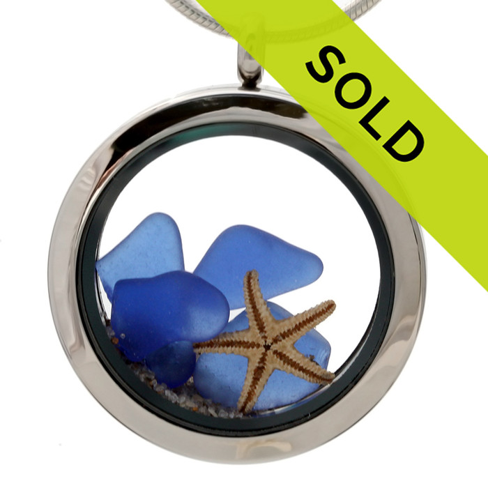 Genuine Blue sea glass pieces combined with a real starfish and beach sand in this sea glass locket necklace.