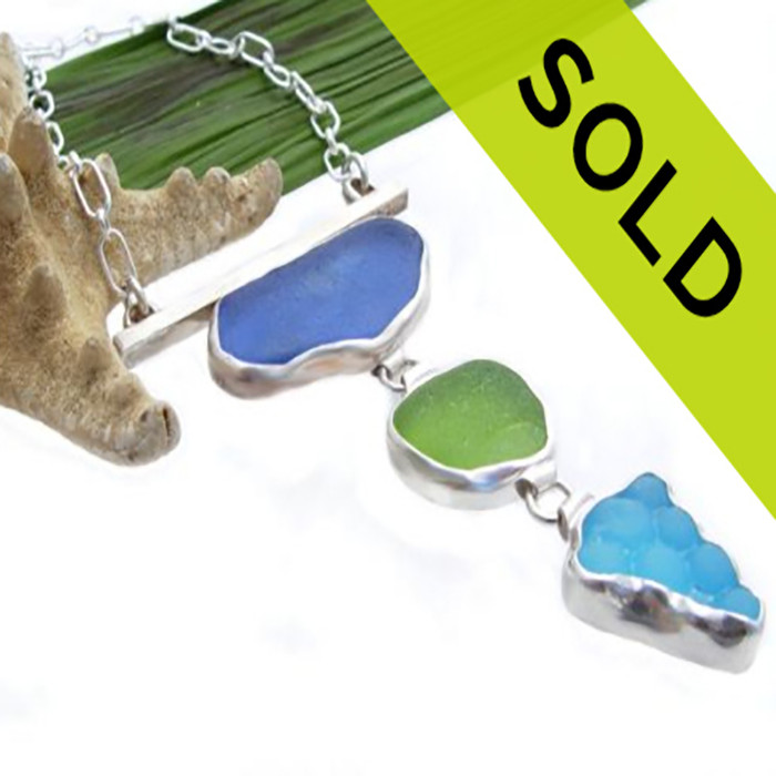 This piece is bezeled in fine silver to show off the stunning quality of this rare sea glass pieces. We do  several of these pieces a year as they are very labor intensive. Look in our Limited Edition section for similar items or email us to see if we can create one specially for you.