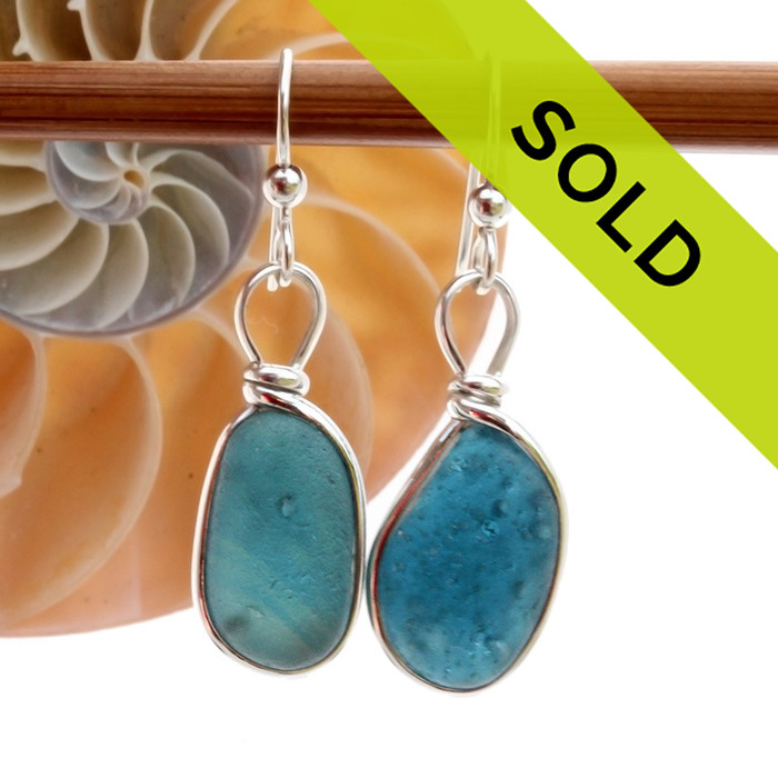 Very unusual bubble teal blue sea glass pieces set in our Original Wire Bezel© sea glass earring setting.