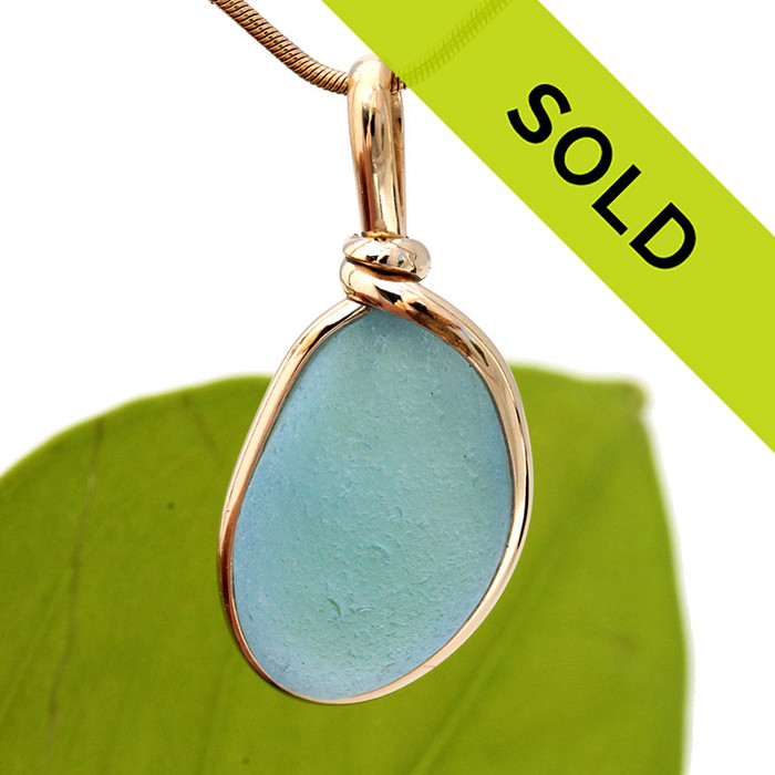 A vivid Bright Blue English sea glass piece is set in our Original Wire Bezel© 14K goldfilled setting. Sorry this sea glass jewelry piece has been sold!