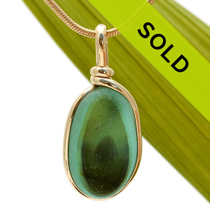 A stunning mixture of green and aqua green in this one of a kind English art sea glass piece. It is set in 14K Rolled Gold in our Original Wire Bezel© setting. Guaranteed for a lifetime of enjoyment!