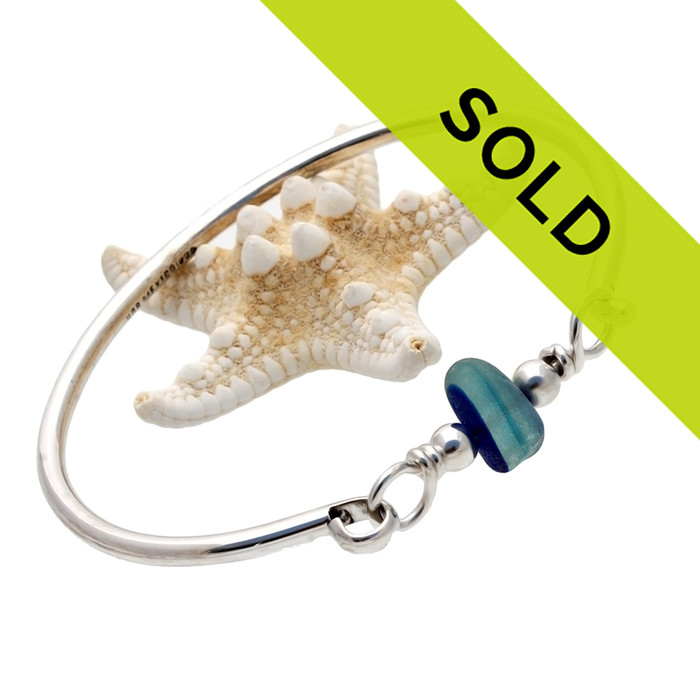 A perfect piece of vivid mixed aqua and blue sea glass combined with sterling beads on a sold sterling bangle bracelet. The sea glass is beach found and tumbled only by tide and time found on the beaches of Seaham England.
