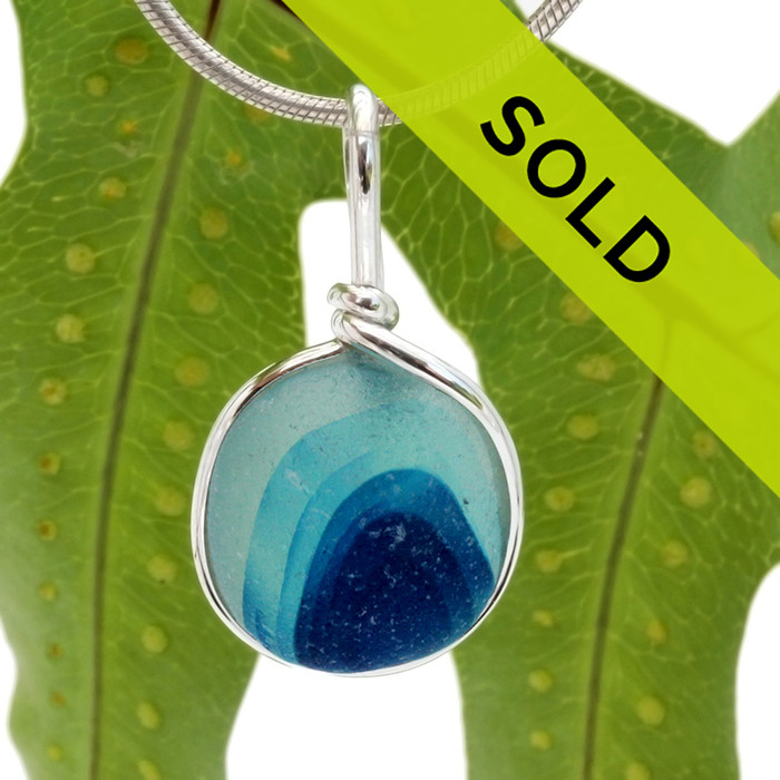 A beautiful piece of vivid aqua and blue green sea glass set for a necklace in our Original Sea Glass Bezel© in solid sterling silver setting.